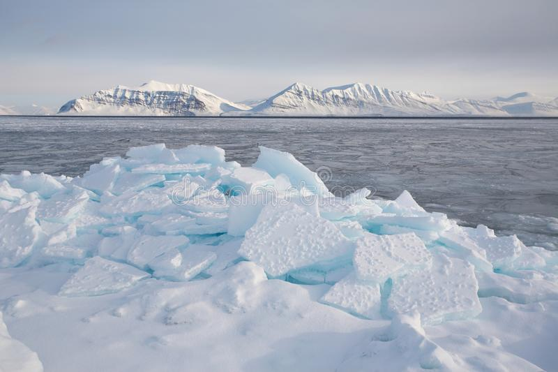 Arctic icy winter landscape. Arctic winter landscape - sea, ice and mountain stock photos