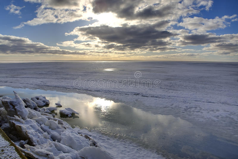 Arctic landscape. View of arctic landscape during sunrise. Frozen water and cloudscapes and block of ice stock images