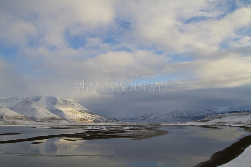 Arctic landscape. With sunlight on the mountains. In Svalbard islands, Norway royalty free stock photography