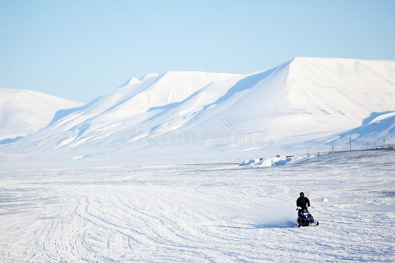 Arctic Landscape. An arctic landscape with a snowmobile in the foreground stock image