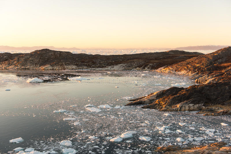 Arctic landscape in Greenland. Around Ilulissat with icebergs and sunset stock images