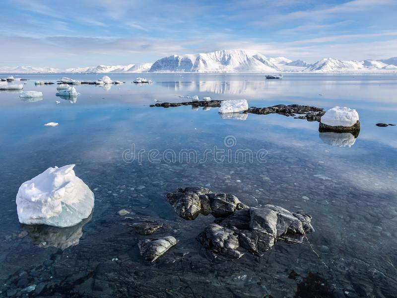 Arctic landscape - ice, sea, mountains, glaciers - Spitsbergen, Svalbard. Arctic landscape - ice, sea, mountains, glaciers royalty free stock image