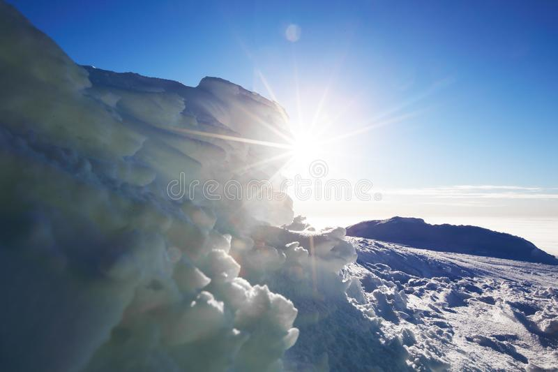 Arctic landscape with ice and sun royalty free stock photography