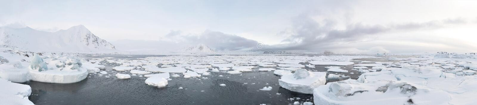 Arctic landscape - PANORAMA. Arctic winter landscape - frozen fjord and glacier royalty free stock photo
