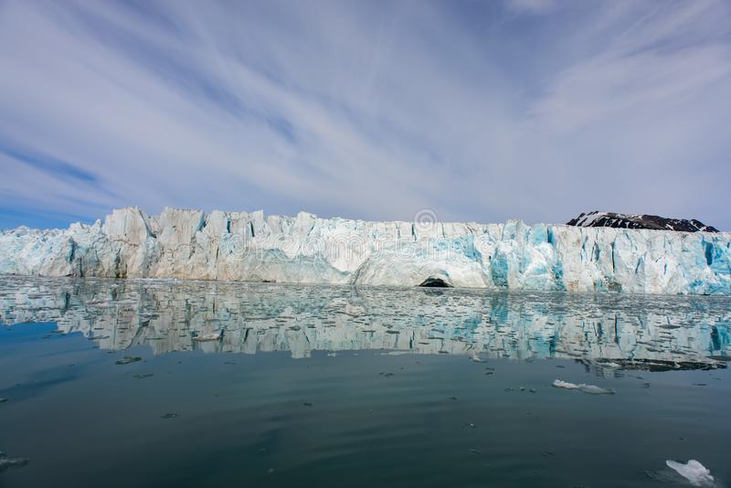 Arctic landscape with glacier in Svalbard with reflection. Arctic landscape with glacier in Svalbard, Norway at summer time. With beautiful reflrction royalty free stock photo