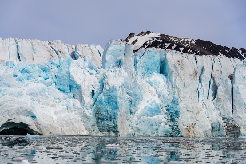 Huge glacier in Svalbard close up. Arctic landscape in Svalbard with glacier in summer time stock images