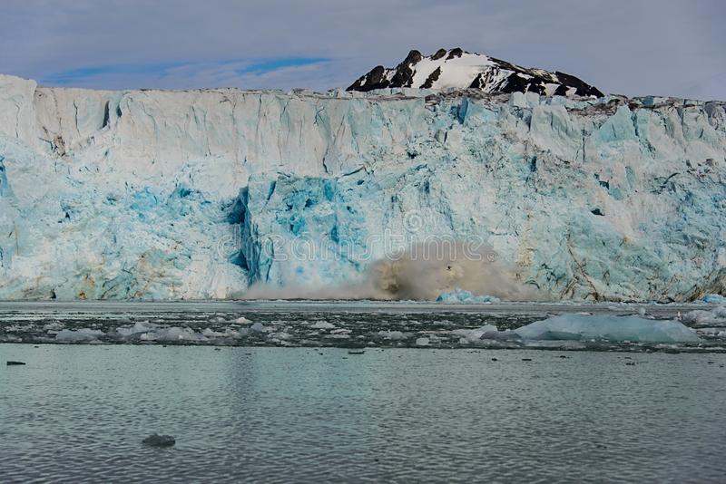 Glacier calving in Svalbard close up. Arctic landscape in Svalbard with glacier in summer time stock images
