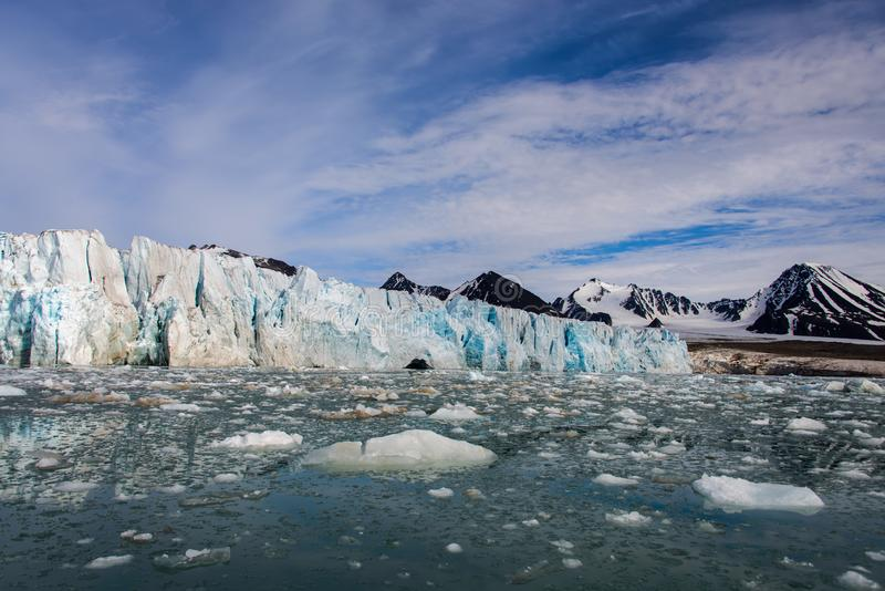 Arctic landscape with glacier in Svalbard with reflection. Arctic landscape with glacier in Svalbard, Norway at summer time. With beautiful reflrction royalty free stock image