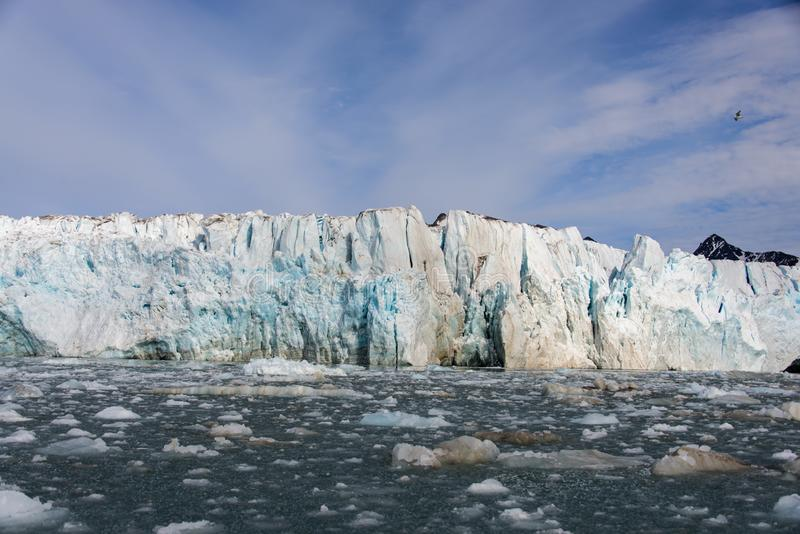 Arctic landscape with glacier in Svalbard with reflection. Arctic landscape with glacier in Svalbard, Norway at summer time. With beautiful reflrction royalty free stock photography