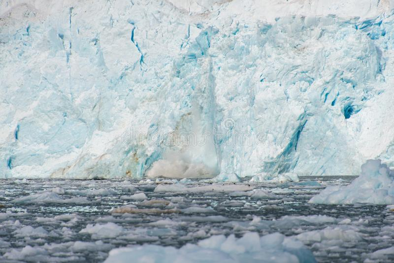 Gacier calving in Svalbard close up. Arctic landscape in Svalbard with glacier in summer time royalty free stock photo