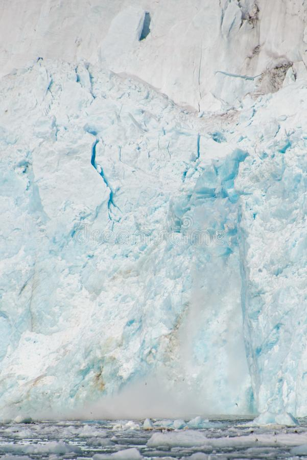 Gacier calving in Svalbard close up. Arctic landscape in Svalbard with glacier in summer time royalty free stock image