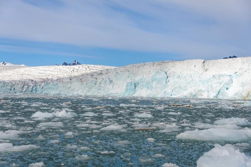 Arctic landscape with glacier in Svalbard with reflection. Arctic landscape with glacier in Svalbard, Norway at summer time. With beautiful reflrction royalty free stock photos