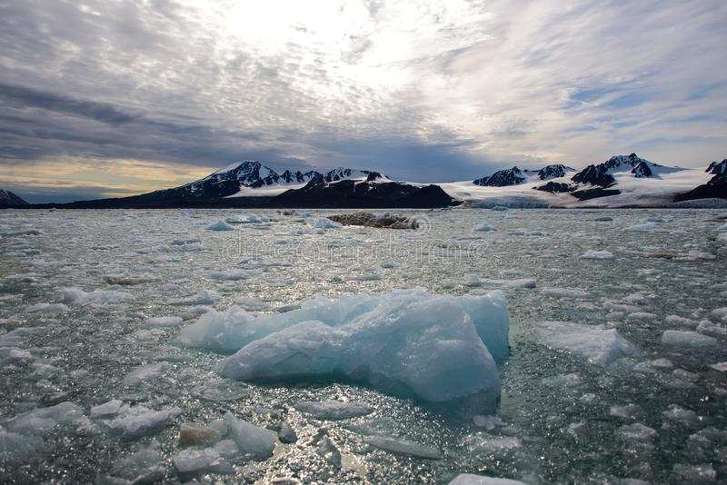 Arctic landscape with glacier in Svalbard with reflection. Arctic landscape with glacier in Svalbard, Norway at summer time. With beautiful reflrction stock images