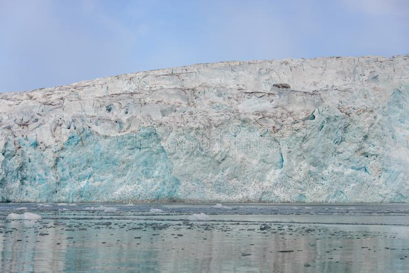 Arctic landscape in Svalbard with glacier in summer time. With sea and reflection royalty free stock photography