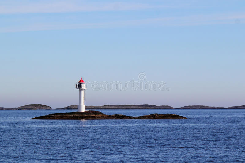 Arctic Lighthouse. Small norwegian lighthouse in Meloey municipaliy, islands, arctic norway royalty free stock photos