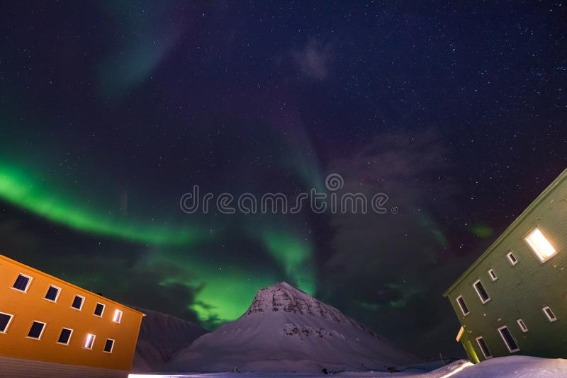 Arctic Northern lights aurora borealis sky star in Norway travel Svalbard in Longyearbyen city the moon mountains. The polar arctic Northern lights aurora stock photos