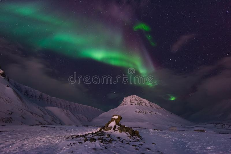 Arctic Northern lights aurora borealis sky star in Norway travel Svalbard in Longyearbyen city the moon mountains royalty free stock photos