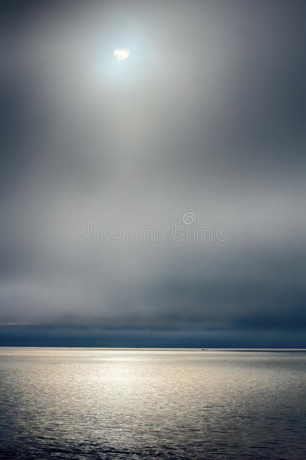 Arctic ocean and midnight sun royalty free stock photography