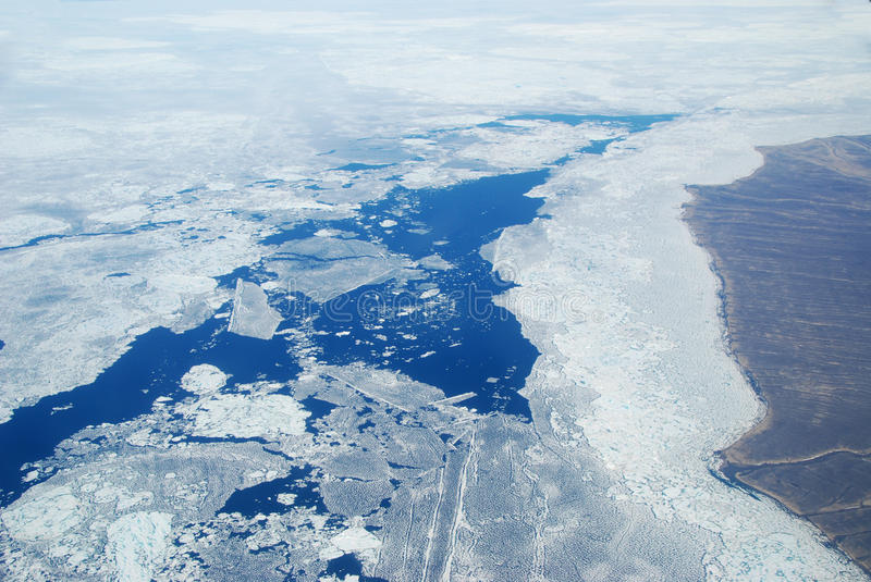 Arctic Sea Ice. An aerial view of sea ice breaking up during the arctic summer stock image
