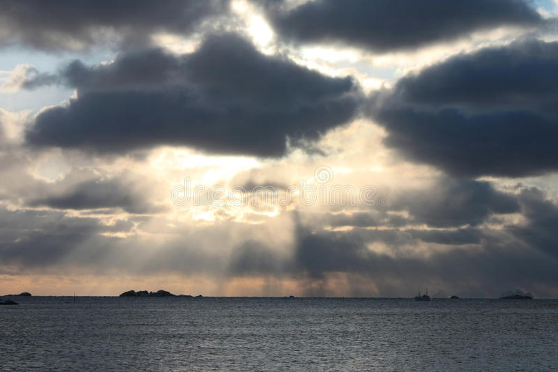 Arctic Sun rays. Sun rays betwenn the clouds on the coast of lofoten islands stock photography