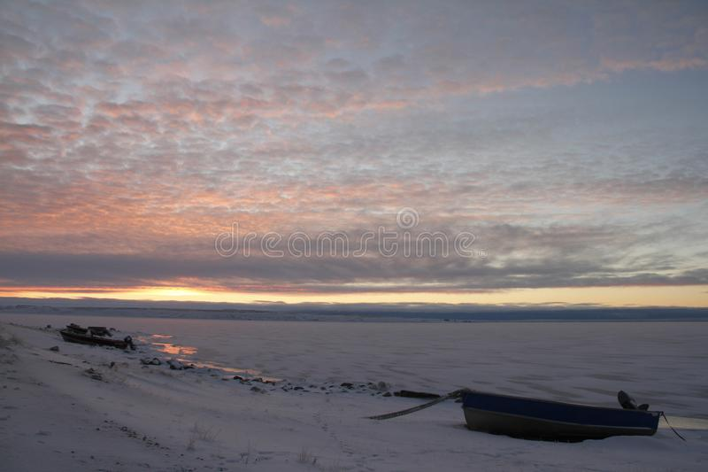 Arctic sunrise with a boat in the foreground stock image