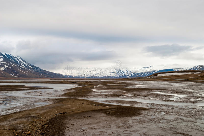 Arctic tundra in early summer mud, Svalbard. Landscape of Arctic tundra in early summer mud, Svalbard royalty free stock photo
