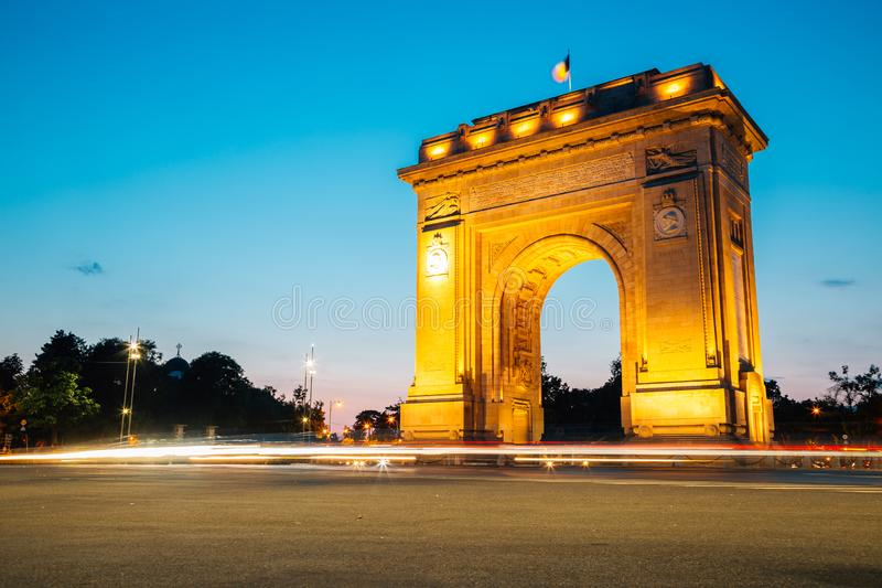 Arcul de Triumf night view in Bucharest, Romania. Historic architecture stock photo