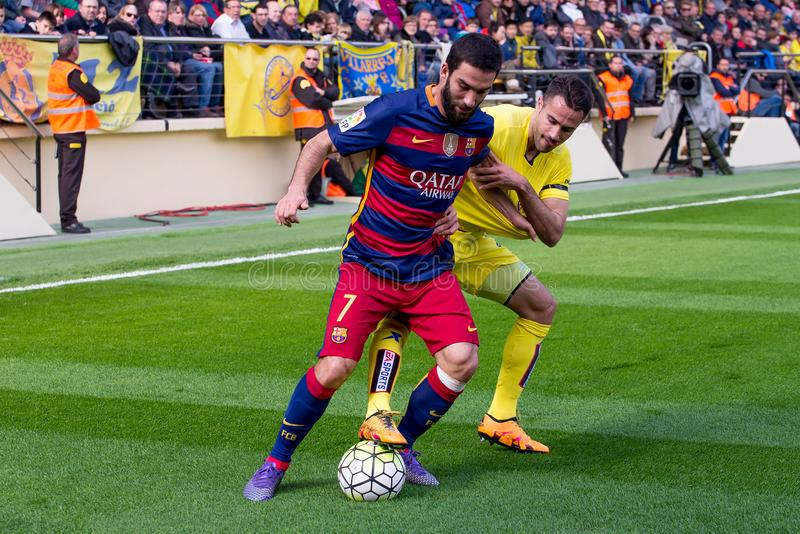 Arda Turan l and Mario Gaspar r fights for the ball royalty free stock photo