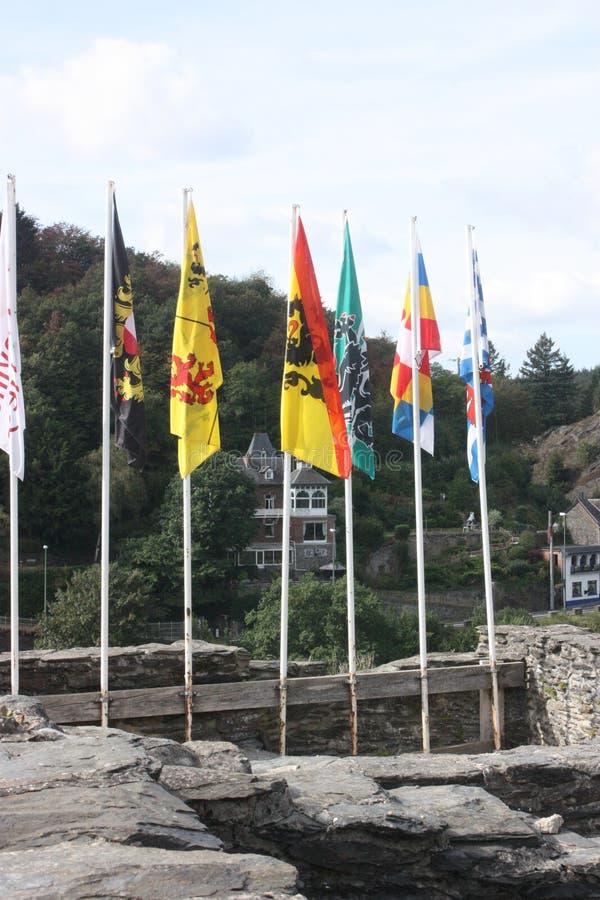 The Ardenne at the location La Roche in Belgium. Castle with flags in the Ardenne at the location La Roche in Belgium royalty free stock image