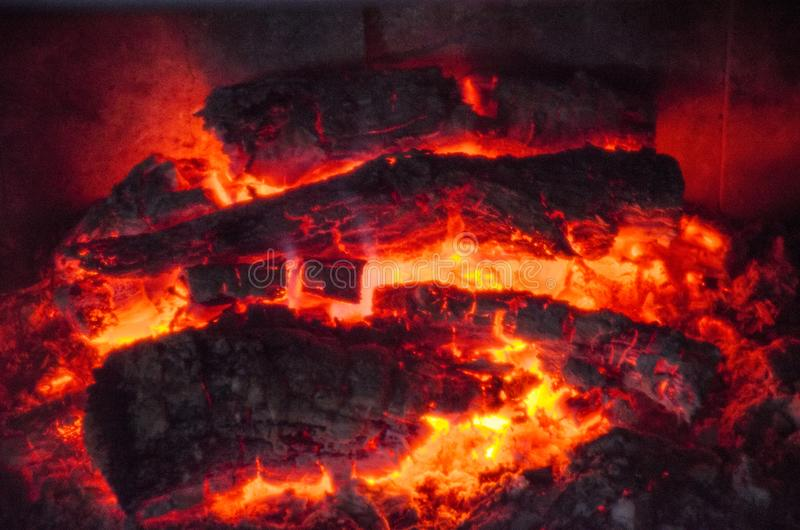 Ardent log and ash into home fireplace. Ardent log and ash into home fireplace stock photos