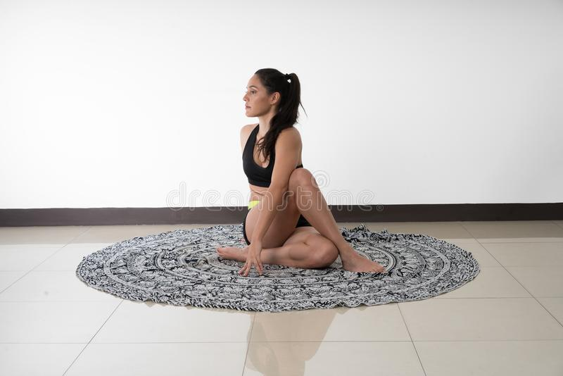 Ardha Matsyendrasana or Half Lord of the Fishes Pose royalty free stock images