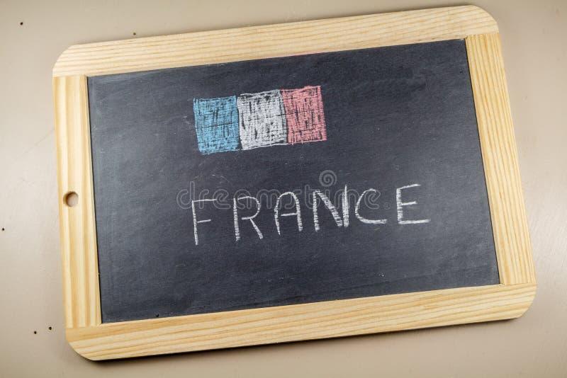 Ardoise de tableau avec le drapeau français photo stock