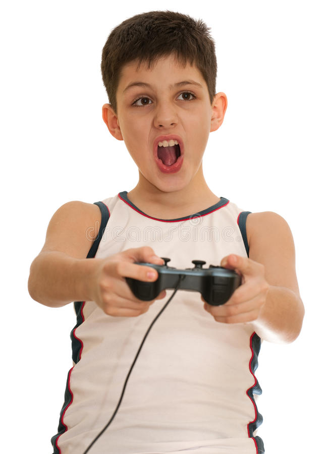 Ardor boy is playing a computer game with joystick. An ardor boy is playing a computer game; isolated on the white background stock image