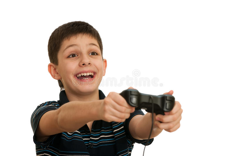Ardor boy is playing a computer game with joystick. An ardor boy in black shirt is playing a computer game using joystick; isolated on the white background stock photos