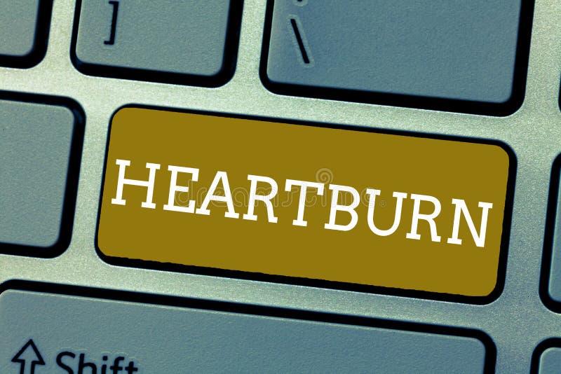 Ardor de estómago del texto de la escritura Concepto que significa la irritación del dolor ardiendo del reflujo ácido del esófago fotos de archivo libres de regalías