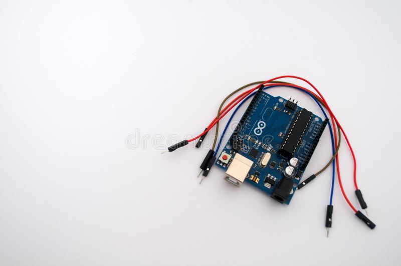Arduino and around listed wire. On a white background royalty free stock images