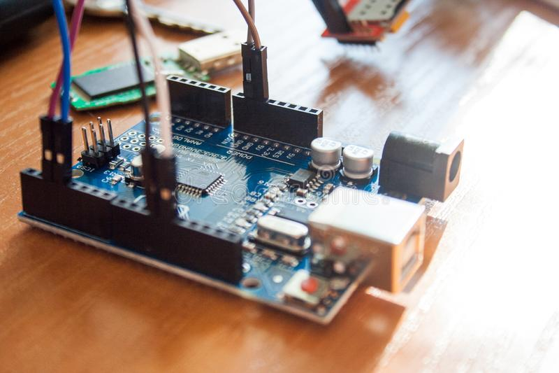 Arduino board micro controller used for building digital devices. An Arduino board micro controller used for building digital devices stock photography