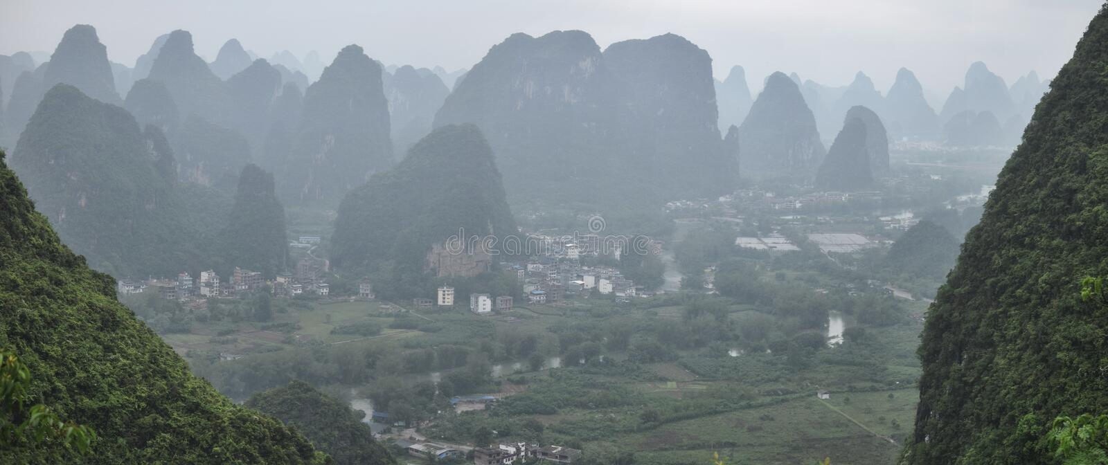 The area around small town Yangshuo in Guangxi Zhuang Autonomous Region in China. Is renowned for its karst landscape where there are hundred upon hundred of stock image