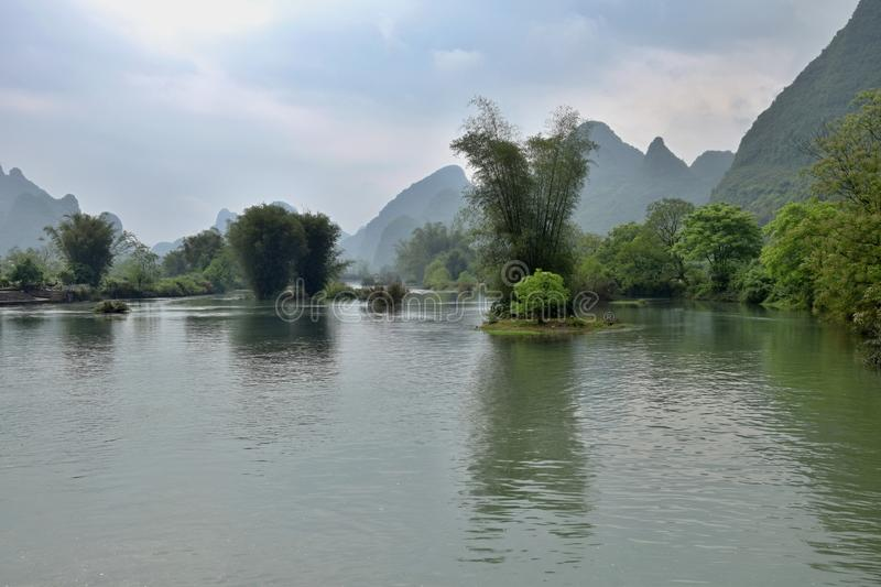 Li river runs through the fairy karst landscape of Yangshuo in Guangxi Zhuang Autonomous Region in China. The area around small town Yangshuo in Guangxi Zhuang royalty free stock image