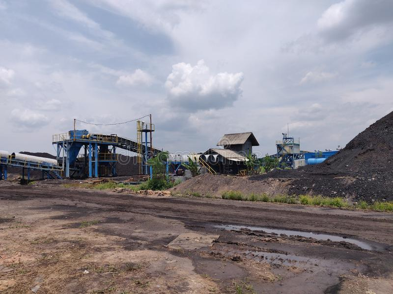 The area of cargo stockpile in nice weather day, coal stockpile stock images