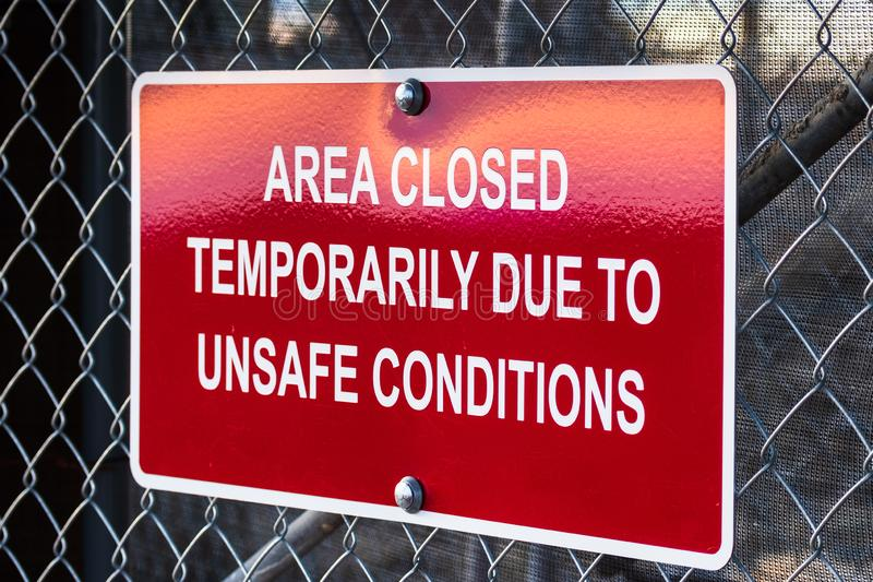 `Area closed temporarily due to unsafe conditions` posted sign royalty free stock photos