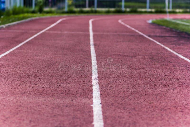 Area di atletica dello stadio vuota un giorno di estate immagini stock libere da diritti