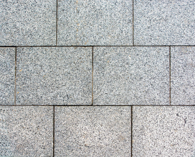 Area laid out of paving stone. Background texture relief stock images