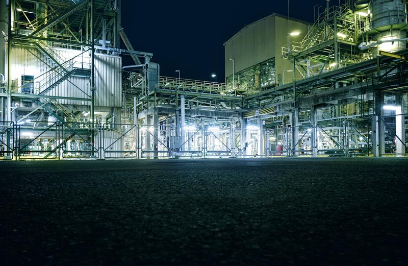 Factory. Area of manufacturing petrochemical industrial plant at night with copy space pavement floor stock images