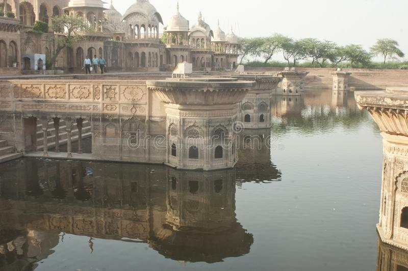 Sacred place with a pond, Mathura, India royalty free stock photo