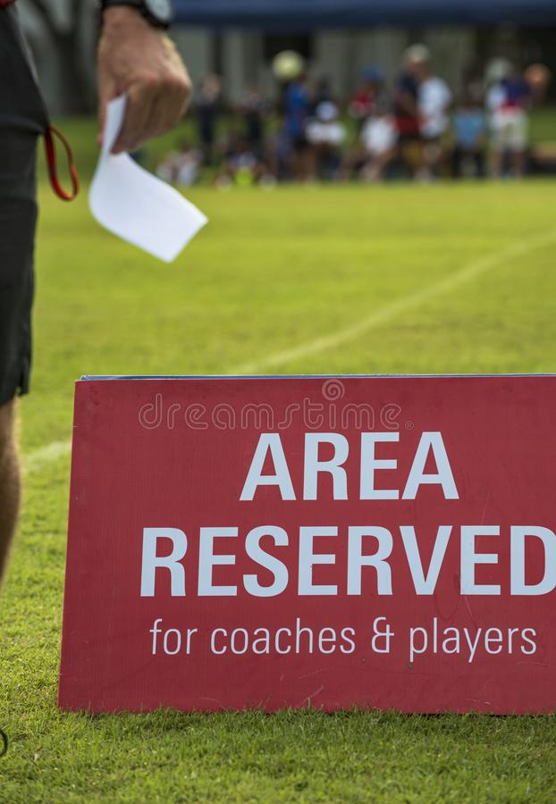 Area reserved banner sign on the sideline of a football pitch in a youth tournamen. royalty free stock image