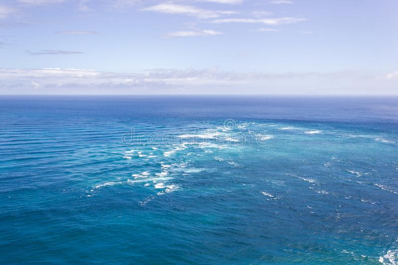 Area of rough water is where the Tasman Sea meets the Pacific Ocean, Cape Reinga New Zealand. The area of rough water is where the Tasman Sea meets the Pacific royalty free stock photography