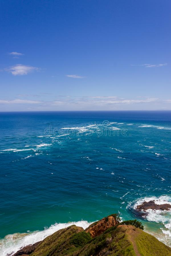 Area of rough water is where the Tasman Sea meets the Pacific Ocean, Cape Reinga New Zealand. The area of rough water is where the Tasman Sea meets the Pacific royalty free stock photos