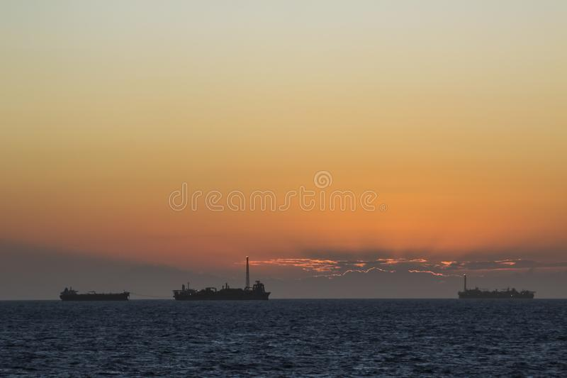 Area of work offshore on the high seas, the oil industry and a beautiful day and sunset. MORE OPTIONS IN MY PORTFOLIO royalty free stock image