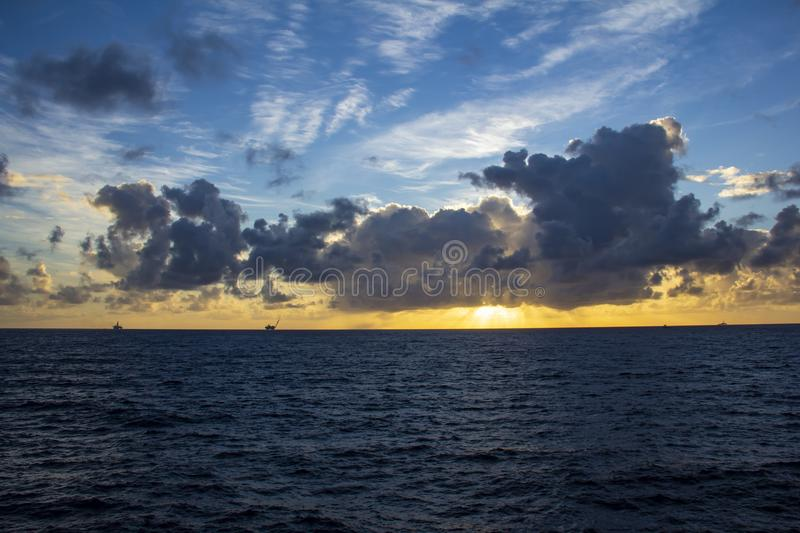 Area of work offshore on the high seas, the oil industry and a beautiful day and sunset. MORE OPTIONS IN MY PORTFOLIO stock photography